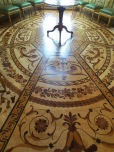The incredible inlaid wood floor of the European monarchs' portrait room at the Royal Castle