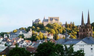Marburg, with the castle atop the hill and the Elisabethkirche to the far right. Photo by PhilippN via Wikipedia.