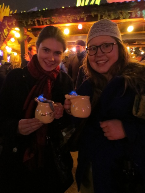 Drinking Feuerzangenbowle (mulled wine, with a sugar cube drenched in rum and lit on fire) with Sonja at the Tollwood Chirstmas market