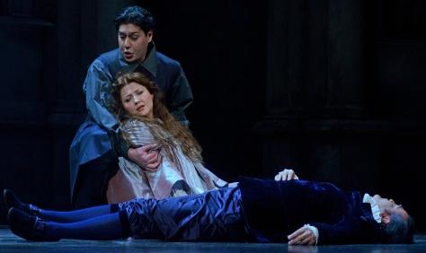 Don Ottavio holding a fainting Donna Anna