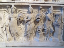 Sily faces in an Etruscan relief
