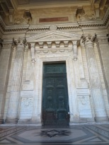 The imposing doors of the Palais de Justice