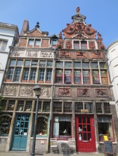 Medieval decoarted facades indicating the profession and faith of the inhabitant