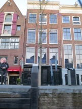 Anne Frank's house is the one in the middle