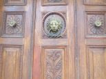 Lions and snakes on the door of the Roman House